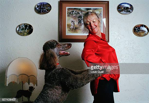 Anne Northfield dog trainer and also dog dancing specialist puts her standard poodle and other pets trough their paces at home in South London Dog...