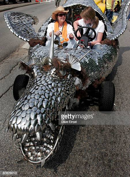Anne Owen and Abigail OwenPontez strap into Elee a car made of cutlery from American Airlines during the Everyones Art Car Parade May 14 2005 in...
