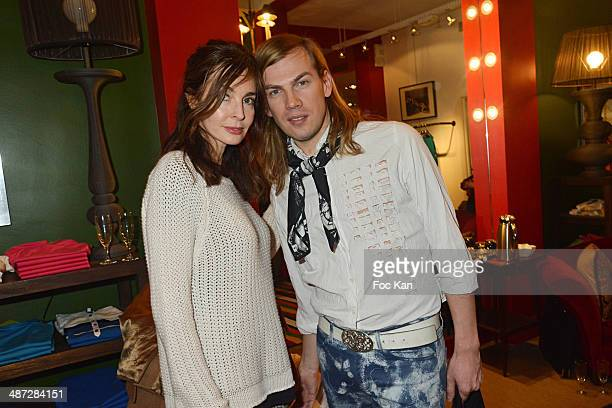 Anne Parillaud Christophe Guillarme attend 'Charriol' Ephemeral Boutique opening hosted by Nathalie Garcon at Galerie Vivienne on April 28 2014 in...