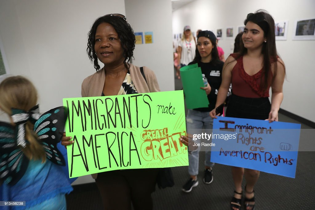 Anne Pierre (C) joins with other activists in front of the office of Sen. Bill Nelson (D-FL) to ask him to help recipients of the Deferred Action for Childhood Arrivals (DACA) as well as all immigrants living in America on February 2, 2018 in West Palm Beach, Florida. The events organizers expressed their concerns about the current political landscape and how they feel it is contributing to the persecution and discrimination of documented and undocumented immigrants.