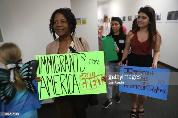 Anne Pierre joins with other activists in front of the office of Sen Bill Nelson to ask him to help recipients of the Deferred Action for Childhood...