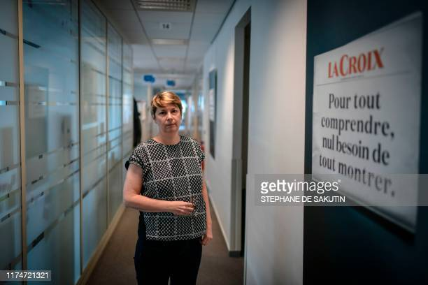 "Anne Ponce manareg editor of the French daily newspaper "" La Croix L'Hebdo "" poses at the newspaper headquarter in Montrouge, Paris, on October 9,..."
