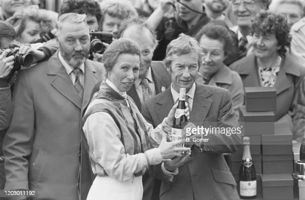 Anne Princess Royal receives a commemorative trophy from British professional jockey Lester Piggott after making her flat racing debut at the...