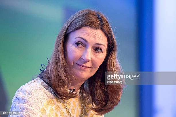Anne Richards chief investment officer and executive director of Aberdeen Asset Management Plc sits and listens during the Milken Institute London...