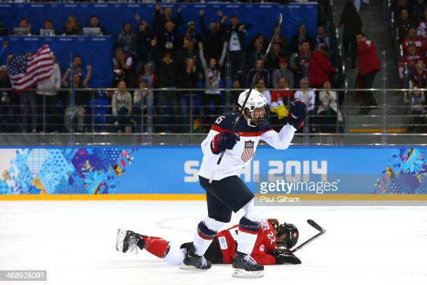 Anne Schleper of the United States celebrates after setting up Hilary Knight to score a goal in the second period as Hayley Wickenheiser of Canada...