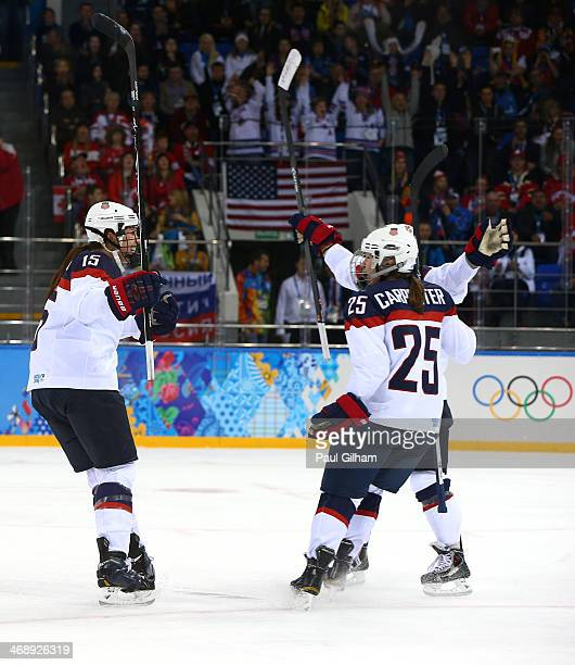 Anne Schleper of the United States celebrates with teammate Alex Carpenter after setting up Hilary Knight to score a goal in the second period...