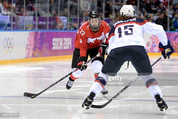 Anne Schleper of the United States challenges Hayley Wickenheiser of Canada for the puck during the Ice Hockey Women's Gold Medal Game on day 13 of...