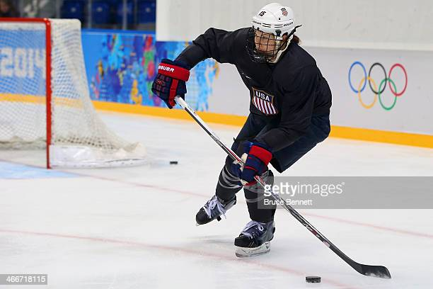 Anne Schleper of the United States handles the puck during a practice session ahead of the Sochi 2014 Winter Olympics at Shayba Arena on February 3...
