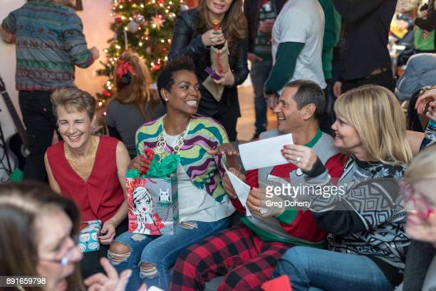 Anne Schoettle Vanessa Williams Thomas Collabro and Lisa Collabro attend The Bay Ugly Sweater And Secret Santa Christmas Party at Private Residence...