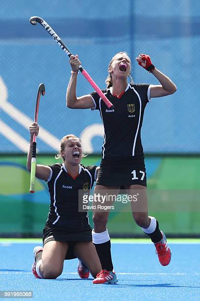 Anne Schroder and Jana Teschke of Germany celebrate defeating New Zealand 21 in the Women's Bronze Medal Match on Day 14 of the Rio 2016 Olympic...