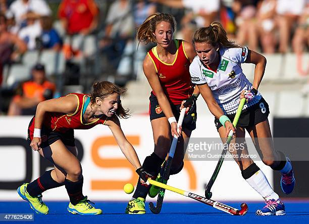 Anne Schroder of Germany is tackled by Carlota Petchame and Cristina Guinea of Spain during the match between Germany and Spain at Polideportivo...