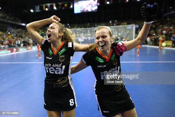 Anne Schroeder and Viktoria Huse of Germany celebrate after the Women Gold Medal Indoor Hockey World Cup Berlin Final Day match between Germany and...