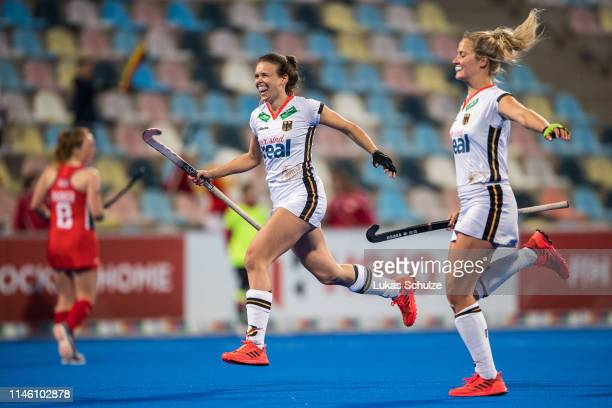 Anne Schroeder of Germany and Hannah Gablac of Germany celebrate their team's second goal during the Women's FIH Field Hockey Pro League match...