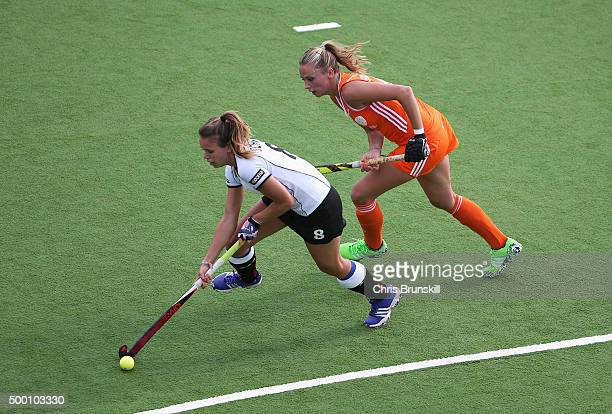 Anne Schroeder of Germany is closed down by Jacky Schoenaker of the Netherlands during the Hockey World League Final Pool A match between the...