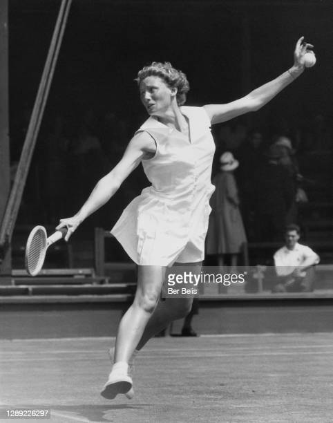 Anne Shilcock of Great Britain makes a backhand return against Darlene Hard of the United States during their Women's Singles Second Round match at...