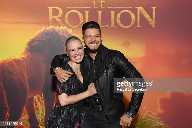 Anne Sila and Rayane Bensetti attend The Lion King Paris Gala Screening At Le Grand Rex on July 11 2019 in Paris France