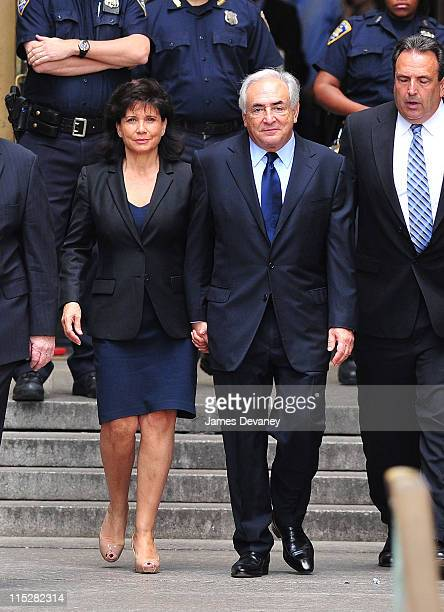 Anne Sinclair and Dominique StraussKahn depart Manhattan Criminal Court following the hearing on StraussKahn's sexual assault charges on June 6 2011...