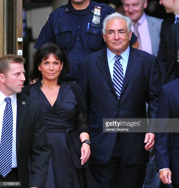 Anne Sinclair and Dominique StraussKahn leave Manhattan Criminal Court to attend a status hearing on the sexual assault charges against StraussKahn...