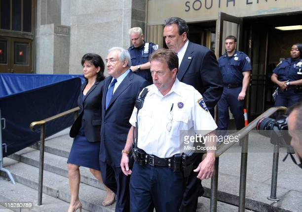 Anne Sinclair and husband Dominique StraussKahn leave Manhattan criminal court after his arraignment hearing o on June 6 2011 in New York City