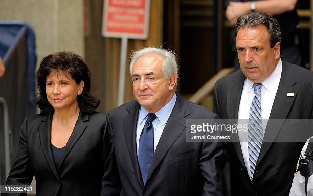 Anne Sinclair and husband Dominique StraussKahn leave Manhattan criminal court after his arraignment hearing on June 6 2011 in New York City