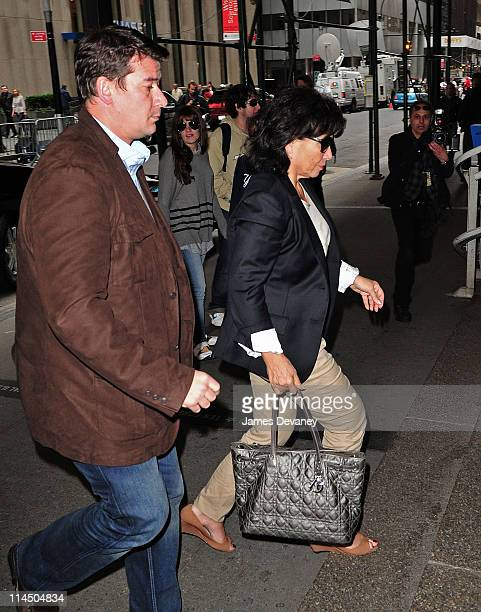 Anne Sinclair arrives at the Manhattan apartment building where Dominique StraussKahn is currently being held under house arrest on May 22 2011 in...