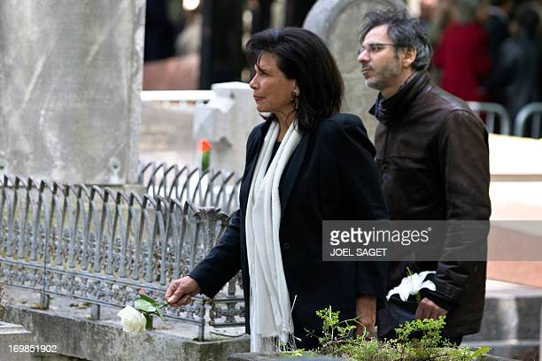 Anne Sinclair editorial director of the French version of the Huffington Post's news website attends on June 3 2013 at the Monmartre cemetery in...