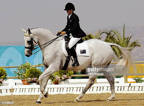 Anne Skiner of Australia rides horse Barkley Castle during the Individual Dressage Free Style testgrade III on September 23 2004 at the Athens 2004...