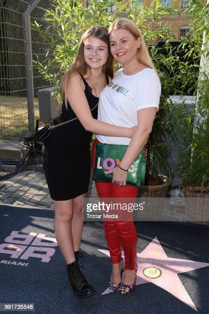 Anne Sophie Briest and her daughter Faye Montana attend the Riani show during the Berlin Fashion Week Spring/Summer 2019 at ewerk on July 4 2018 in...
