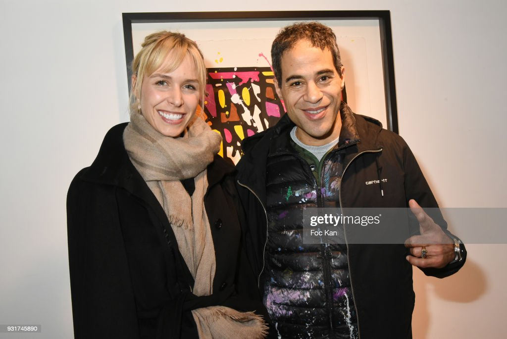 Anne Sophie Kamar and JonOne attend ÔBirth of The WindÕ JonOne Preview at Galerie Brugier Rigail on March 13, 2018 in Paris, France.