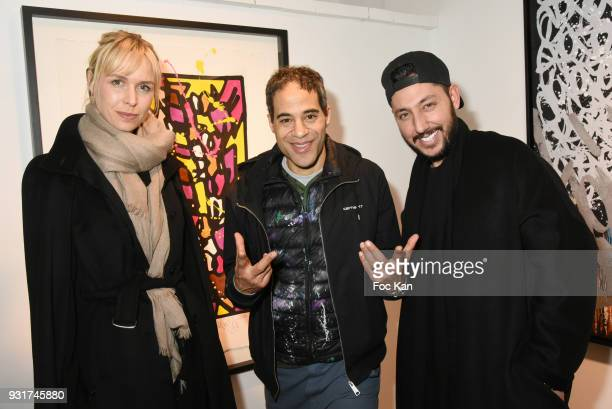 Anne Sophie Kamar JonOne and singer Cyril KamarÊ attend ÔÔBirth of The WindÕ JonOne PreviewÊÈ at Galerie Brugier Rigail on March 13 2018 in Paris...