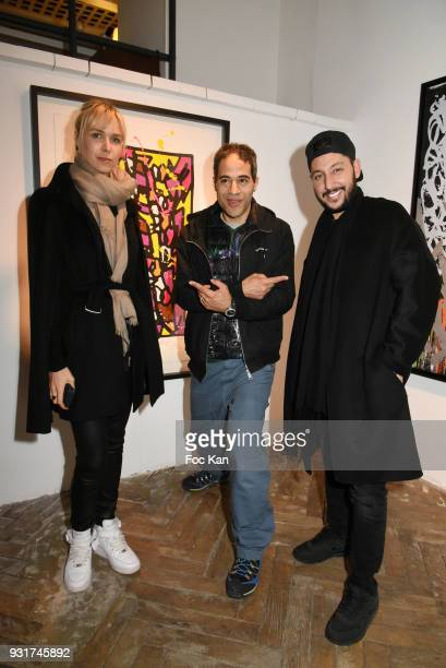 Anne Sophie Kamar JonOne and singer Cyril KamarÊ attend ÕBirth of The WindÕ JonOne PreviewÊat Galerie Brugier Rigail on March 13 2018 in Paris France