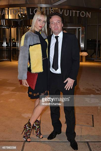 Anne Sophie Mignaux and Emmanuel Perrotin attend the Foundation Louis Vuitton Opening at Foundation Louis Vuitton on October 20 2014 in...
