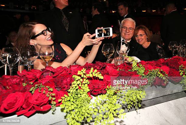 Anne Springfield takes a cellphone photo of her husband honoree Steve Martin and filmmaker Nancy Meyers during the 2015 AFI Life Achievement Award...