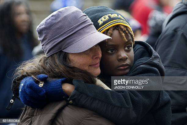 Anne Sullivan embraces her son Jay during Denver's Martin Luther King Jr parade on January 2017 Denver's Martin Luther King Jr parade is the largest...