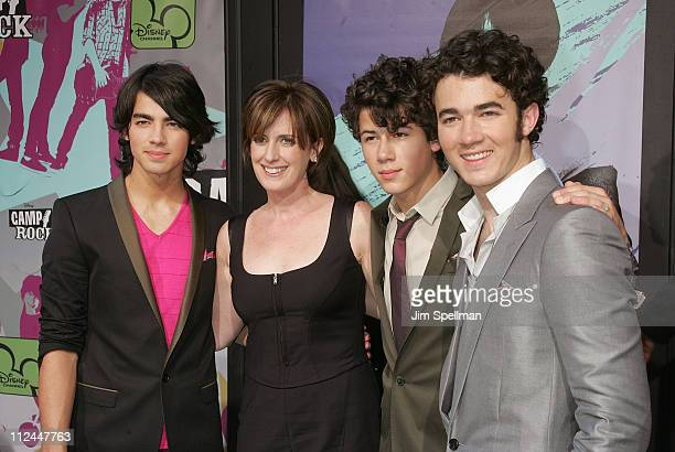 Anne Sweeney CoChair Disney Media Networks President Disney ABC Group with musicians Joe Jonas Nick Jonas and Kevin Jonas attend the 'Camp Rock'...