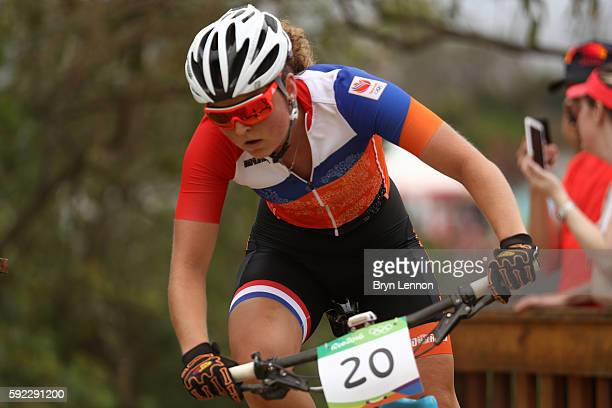 Anne Terpstra of Netherlands races during the Women's CrossCountry Mountain Bike Race on Day 15 of the Rio 2016 Olympic Games at the Mountain Bike...