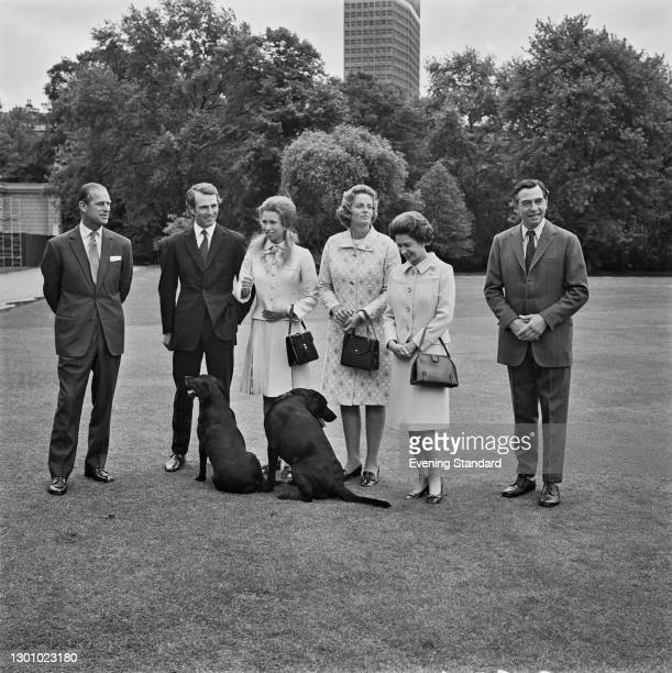 Anne, the Princess Royal, poses with her fiancé, equestrian champion Mark Phillips and their parents in the grounds of Buckingham Palace in London,...