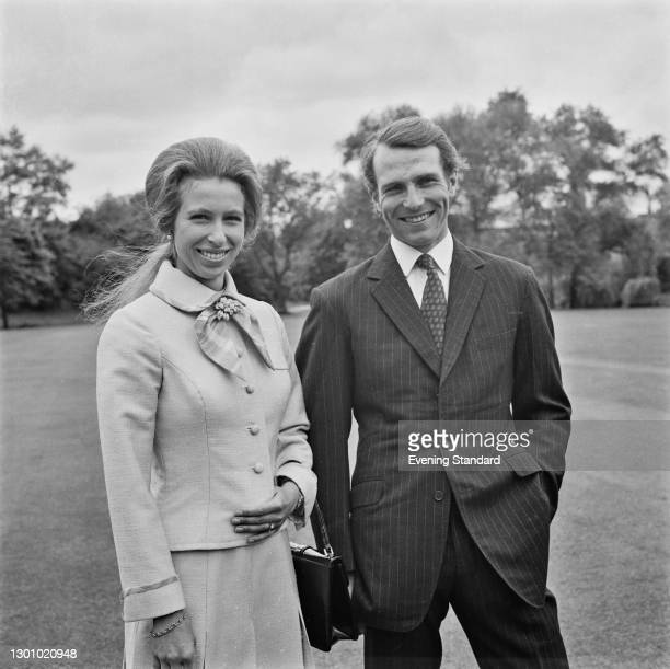 Anne, the Princess Royal, with her fiancé, equestrian champion Mark Phillips in the grounds of Buckingham Palace in London, following the...