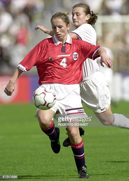 Anne Tonnesen of Norway keeps the ball away from Carla Overbeck of the US during first half action of their friendly game played at the Lockhart...