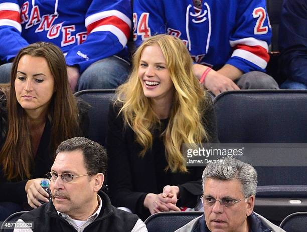Anne V and guest attend the Philadelphia Flyers vs New York Rangers playoff game at Madison Square Garden on April 27 2014 in New York City
