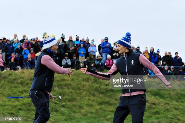 Anne Van Dam and Suzann Pettersen of Team Europe celebrate winning the seventh hole during Day 2 of the Solheim Cup at Gleneagles on September 14...