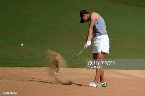Anne van Dam of Netherlands plays out the bunker on the 18th hole during Day One of the Fatima Bint Mubarak Ladies Open at Saadiyat Beach Golf Club...