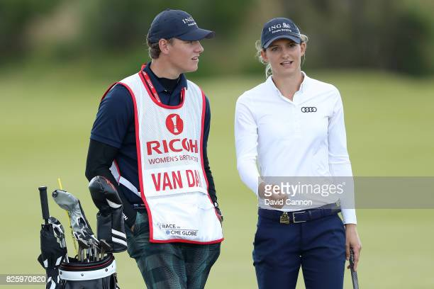 Anne Van Dam of the Netherlands looks on with her caddie during the first round of the Ricoh Women's British Open at Kingsbarns Golf Links on August...