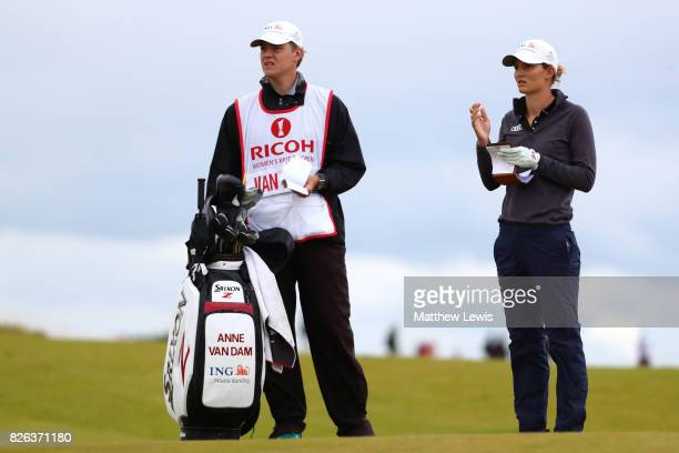 Anne Van Dam of the Netherlands looks on with her caddie on the 4th hole during the second round of the Ricoh Women's British Open at Kingsbarns Golf...