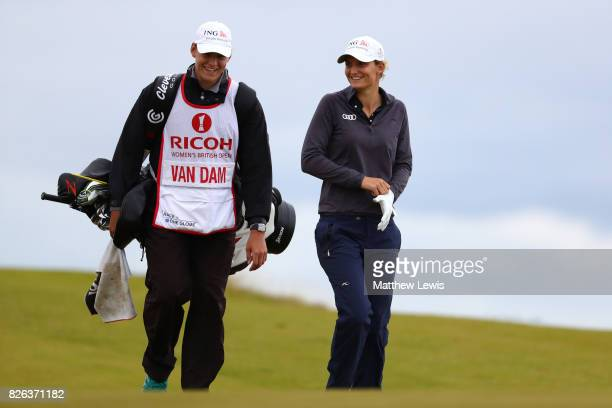 Anne Van Dam of the Netherlands walks with her caddie on the 4th hole during the second round of the Ricoh Women's British Open at Kingsbarns Golf...