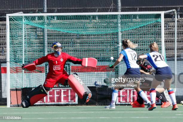 Anne Veenendaal of Amsterdam Dames 1 Delfina Merino of SCHC Dames 1 Sarah Jaspers of SCHC Dames 1 during the Hoofdklasse Women match between...
