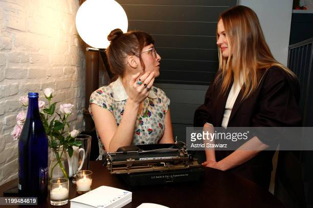 Anne Vyalitsyna receives a custom poem by Lisa Ann Markuson during the Bambini Furtuna Launch Brunch at The Little Owl Townhouse on January 14, 2020...