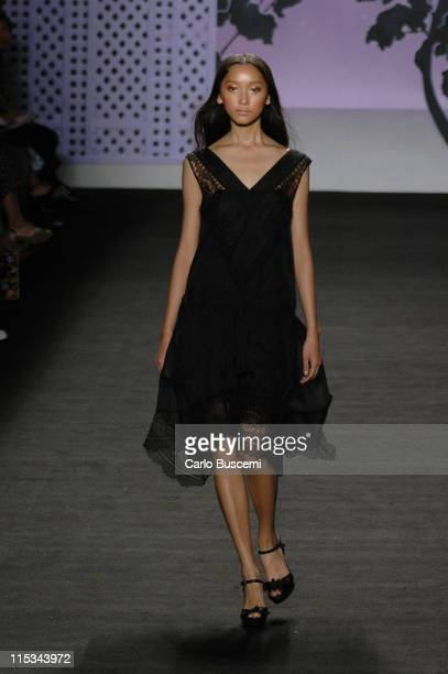 Anne Watanabe wearing Anna Sui Spring 2006 during Olympus Fashion Week Spring 2006 - Anna Sui - Runway at Bryant Park in New York City, New York,...
