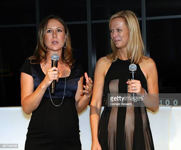 Anne Wojcicki and Linda Avay introduce themselves during the 23 and Me Spit party at the IAC Building on September 9 2008 in New York City