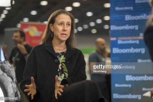 Anne Wojcicki chief executive officer and cofounder of 23andMe Inc speaks during a Bloomberg Technology Television interview at the TechCrunch...